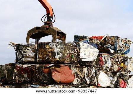 Large blocks of low grade steel at a metal recycle scrap yard - stock photo
