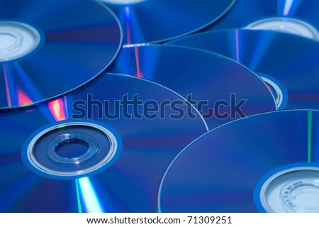 Large Blue dvd discs background - stock photo