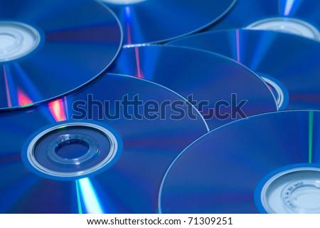 Large Blue dvd discs background - stock photo