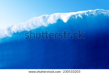 Large Blue Surfing Wave Breaks in the Ocean - stock photo