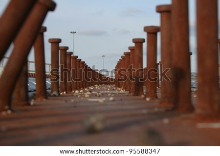 Large bolts as part of road construction - stock photo