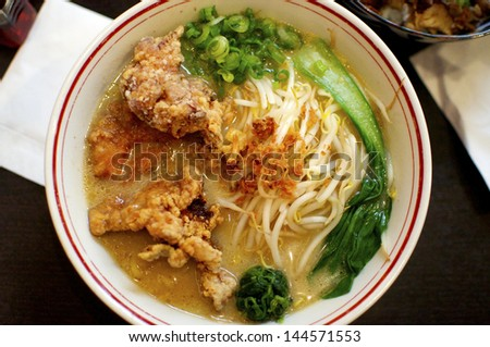 Large Bowl of Ramen Soup with Tempura in it. A typical Japanese Dish. - stock photo