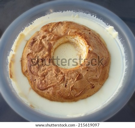 Large bowl of traditional eggnog dish with whipped baked yolk meringue on top - stock photo