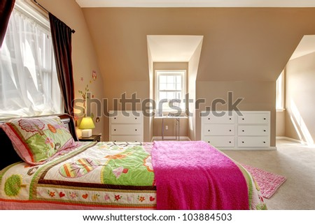 Large brown baby girl bedroom interior with pink bed. - stock photo