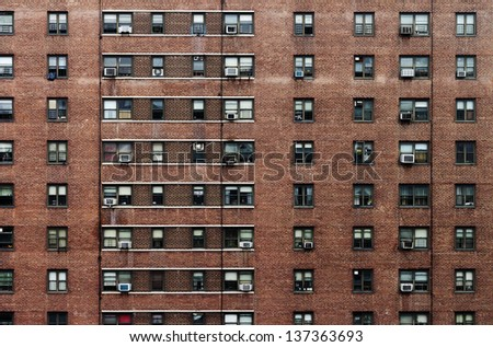 Large Building With Windows on a Brick Wall Square Elevation Texture - stock photo