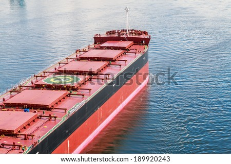 Large bulk carrier with Helicopter Pad on the deck. - stock photo