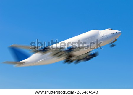 Large cargo carrier plane with blurred motion effect signifying speed - stock photo