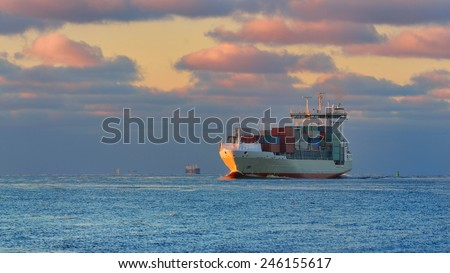 Large cargo container ship sailing against the sunset . Riga, La - stock photo