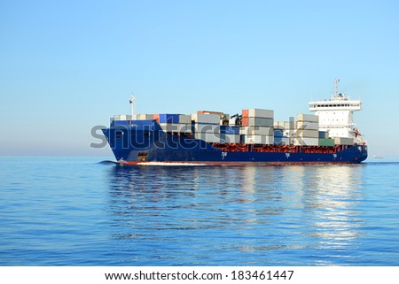Large cargo container ship sailing in a bright sunny day. Riga,  - stock photo