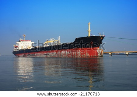 Large cargo ship in a harbor - stock photo
