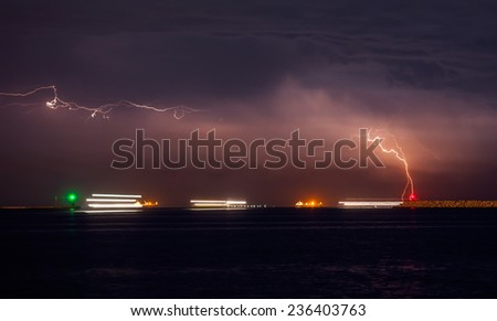 large cargo ship over the sea at night (long exposure) - stock photo