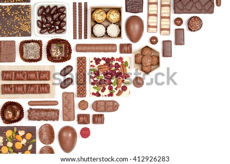 large chocolate selection on white background. flat lay composition with copy space top view - stock photo