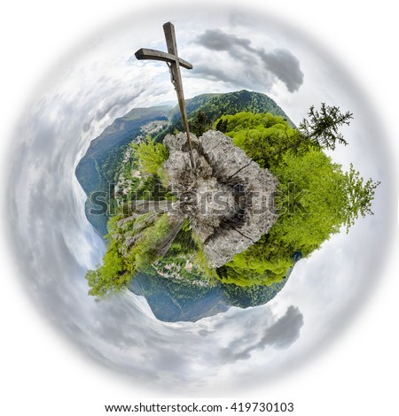 Large Christian wooden cross on a mountain peak of 360 degree miniplanet. Panoramic montage from 16 HDR images - stock photo