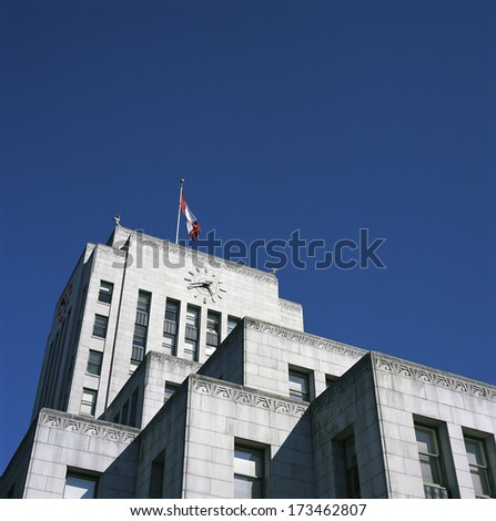 Large city hall building with canadian flag - stock photo