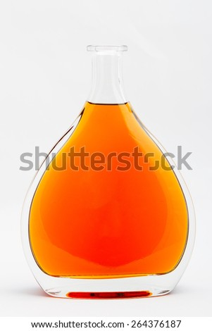 large clear glass bottle isolated on white background - stock photo