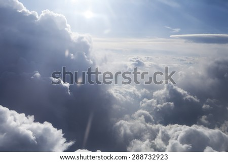 large clouds with a glow of sun as seen from an airplane. - stock photo
