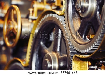 Large cog wheels in the motor - selective focus - stock photo