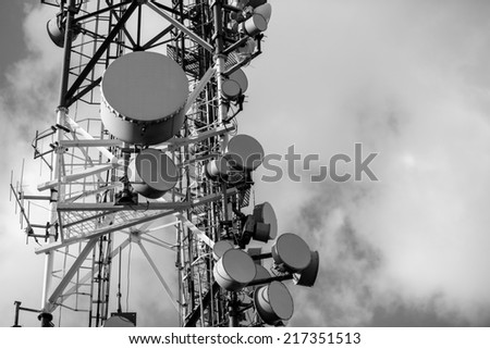 Large Communication tower against sky outdoors in black and white - stock photo