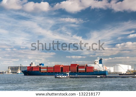 Large container ship entering Antwerp harbor - all brands and logos have been removed - stock photo