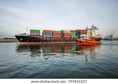 large container ship leaving harbour - stock photo