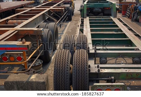 Large container trailer chassis used for transporting shipping containers - stock photo