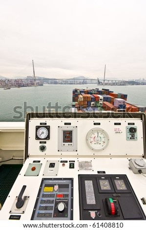 Large Container Vessel approaching Stone cutters Bridge, Hongkong, view from the Port Wing - stock photo
