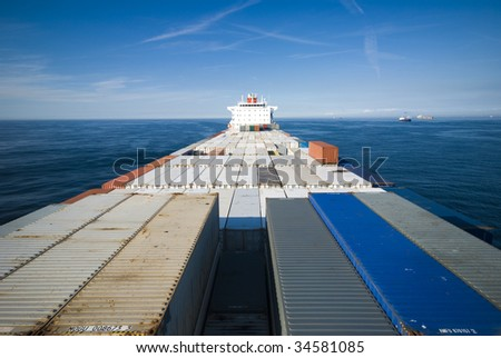 large container vessel ship and the horizon, no logos in this picture - stock photo
