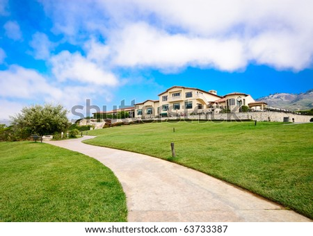 Large Country Club on Grass Hill - stock photo