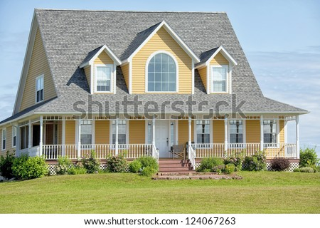 Large country home with welcoming veranda. - stock photo
