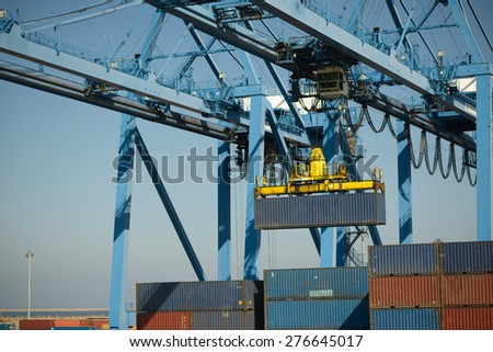 large crane moves the metal container - stock photo