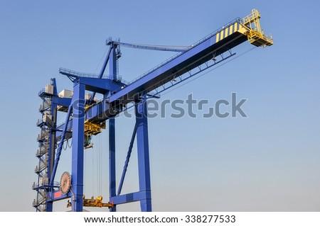 large cranes in sea cargo port of Rotterdam - stock photo