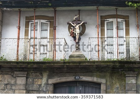 Large crucifix on the facade of a house in ruins - stock photo
