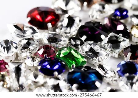 Large crystal strasses on a white background - macro photo - stock photo