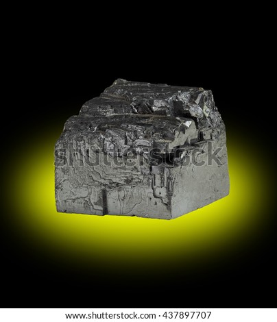 Large cubic crystal of the mineral Galena (Lead Sulfide) displaying typical square face cleavage fractures. - stock photo