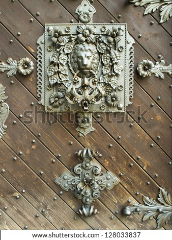 large doorknocker like lion head - stock photo