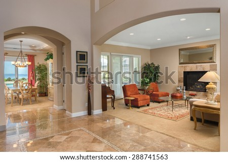 Large Entry with living room and dining room in huge home.  - stock photo