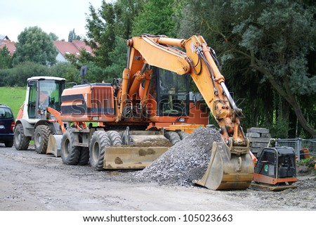 large excavator at the construction site in germany - stock photo