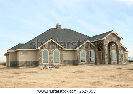 Large expensive modern house in construction - stock photo