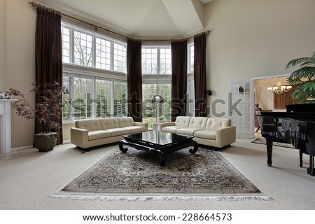 Large family room with two story windows - stock photo