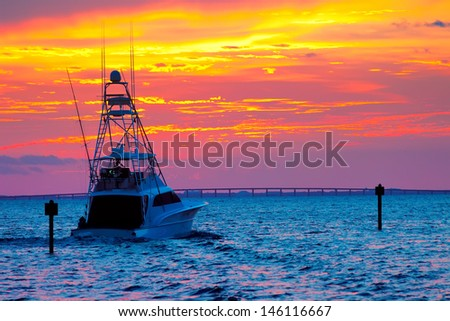 Large fishing boat going out for a sunset cruise in Destin, Florida - stock photo
