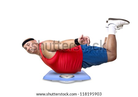 Large fitness man with a weight scale - stock photo