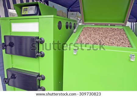 Large furnace for pellets, renewable wooden material - stock photo