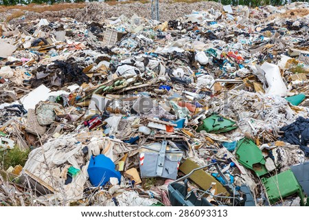 Large garbage dump outside of the city - stock photo