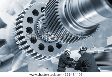 large gear machinery axle and two industry workers - stock photo