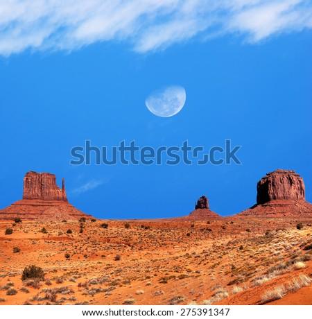 Large gibbous moon over Monument Valley Arizona - stock photo