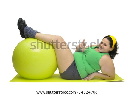 Large girl exercising with big fitness ball isolated in white - stock photo
