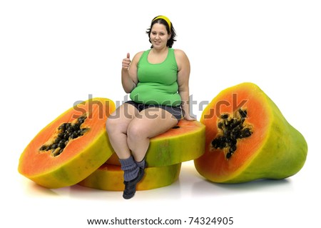 Large girl in a papaya fruit isolated in white - stock photo