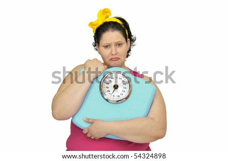 Large girl with sad face and scale isolated in white - stock photo