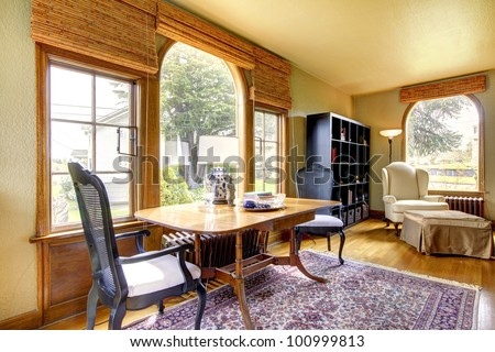 Large gold antique living room interior with table and rug. - stock photo