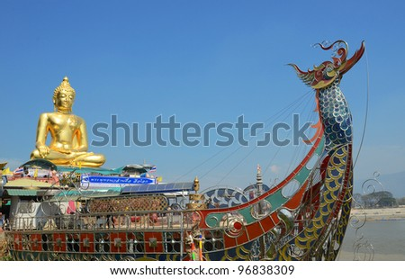 Large golden Buddha center of the golden triangle Chiang Rai Thailand - stock photo